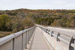 Side walk by the bridge. View of fall colors from side walk by the brige Stock Photos