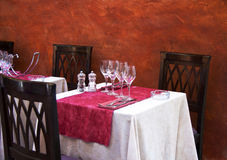 Side walk cafe. Side walk cafe in Europe with table set for diners Stock Photography