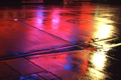 Side walk lights. Night lights reflecting off of a rainy wet side walks Royalty Free Stock Image