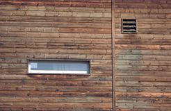 Side wall of a barn. /silo with a small window and air vent Royalty Free Stock Photo