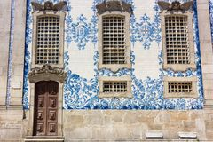 The blue and white tiles azulejo on Carmo Church in Porto, Portugal stock photos