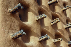 The side wall of a Dogon mud mosque Stock Image