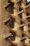 Side wall of a Dogon mud mosque Stock Image