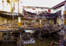 A collapsing restaurant over a river royalty free stock photo
