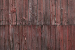 The side of a weathered barn. Closeup side of a weathered red barn, Stowe, Vermont, USA Royalty Free Stock Photo