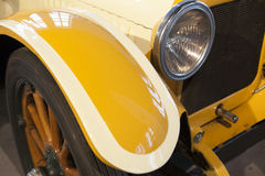 Side wheel headlamp and mudguard detail in a classic car Royalty Free Stock Photo