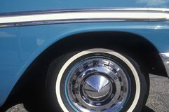 A side wheel and panel of a blue 1956 Chevrolet Royalty Free Stock Photography