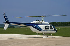 Side of white helicopter. Parked at airport royalty free stock images