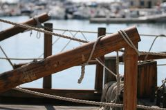 Knotted rope on wooden boat side royalty free stock photography