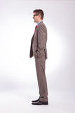 Side of young business man with hands in pockets Royalty Free Stock Photography
