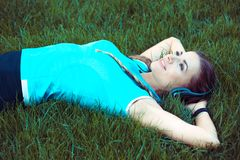 Relaxing fit woman lying on meadow stock photos