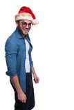 Side a young man in jeans shirt and christmas hat Royalty Free Stock Image