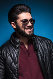 Side of a young man with nice hairstyle and beard smiling Stock Photo