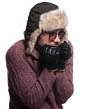 Side of a young man worrying about cold weather Stock Photography