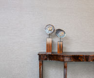 Sideboard in front of a grey wall Stock Photos