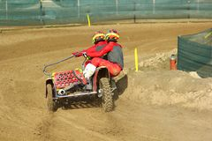 Sidecar motocross athletes on the dirt turn royalty free stock photo