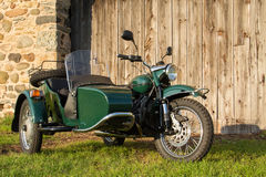 Sidecar Motorcycle - with Rustic Background. Sidecar motorcycle in front of fieldstone and weathered wood background Stock Photography