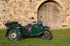 Sidecar Motorcycle - with Rustic Background. Sidecar motorcycle in front of fieldstone and weathered wood background. Copy space royalty free stock image
