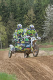 Sidecar riders in the race. Vertically. Royalty Free Stock Images