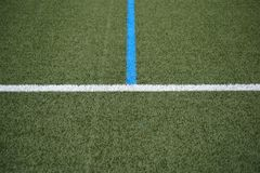 Sideline football field. The green lawn surface of a soccer field with the side line and the center line stock photo