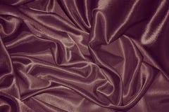 Siden- bakgrund för choklad: Materielfoto Royaltyfria Bilder