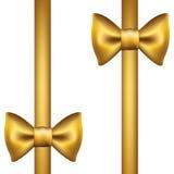 Siden- guld- band med en pilbåge Royaltyfri Bild