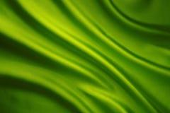 Siden- tyg vinkar bakgrund, grön satängtorkduk för abstrakt begrepp Fotografering för Bildbyråer