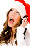 Sidepose of christmas woman listening music. Side pose of christmas woman listening music on an isolated background stock images