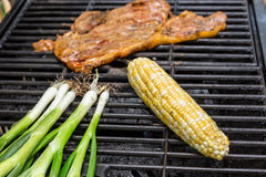 The Sides. A piece of Steak with scallions and corn Royalty Free Stock Image