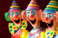 Sideshow Carnival Clowns. A row of sideshow carnival game clowns with mouths open.  Focus to middle clown Stock Photography