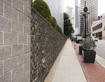 SideSidewalk in a business area in one-point perspective Stock Image