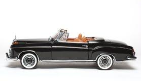 Sideview 1958 del coche del juguete de la escala del metal del SE del Benz 220 de Mercedes Fotos de archivo