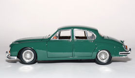 Sideview 1959 del coche del juguete de la escala del metal de la marca 2 del jaguar Foto de archivo