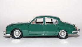 Sideview 1959 dell'automobile del giocattolo della scala del metallo del contrassegno 2 del giaguaro Fotografia Stock