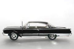 Sideview 1960 dell'automobile del giocattolo della scala del metallo del Ford Starliner Immagine Stock Libera da Diritti