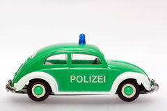 Sideview allemand de coléoptère de VW de véhicule de police de jouet Photographie stock libre de droits