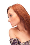 Sideview attractive red-haired girl. Isolated profile of attractive red-haired girl with long eyelashes Royalty Free Stock Image
