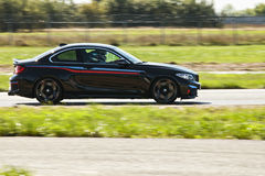 Sideview of black BMW car on road Royalty Free Stock Images