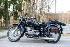 Sideview of black oldtimer motorbike with sidecar Stock Photos