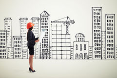 Sideview of businesswoman in orange hardhat Royalty Free Stock Photography