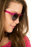 Sideview of a female model wearing sun glasses Royalty Free Stock Image
