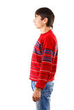 Sideview. Man in striped red sweater standing in profile isolated on white background Stock Photography