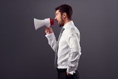 Sideview portrait of businessman with megaphone Stock Images