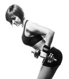 Sideview of redhead fit woman doing bent-over two-arm dumbbell t Stock Images