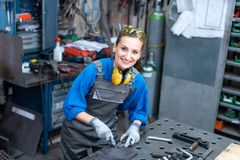 Sideview of worker woman marking piece of metal royalty free stock photography
