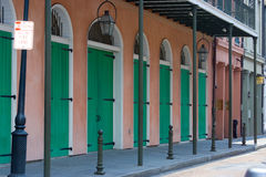 Sidewalk. With green door on a pink building Stock Images