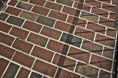 Sidewalk. Brick sidewalk with sunlight and shadows Royalty Free Stock Photos