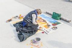 Sidewalk artist. Female pavement artist in Berlin, Germany Stock Photo