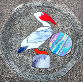 Sidewalk artwork, Pelican Stock Image