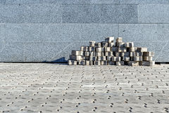 The sidewalk blocks which are accurately put near a granite wall Royalty Free Stock Photos